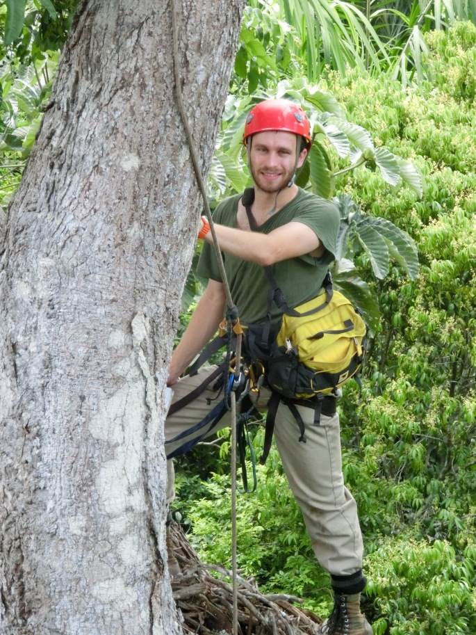 Posing for a photo after a quick climb into the canopy. Photo Credit: Steve Yanoviak